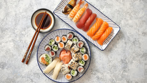 Asian-food-assortment-Various-sushi-rolls-placed-on-ceramic-plates
