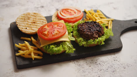 Two-tasty-grilled-home-made-burgers-with-beef-tomato-onion-and-lettuce