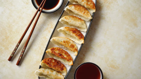 Orginal-asian-dumplings-gyoza-served-in-long-plate