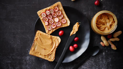 Toasts-bread-with-homemade-peanut-butter-served-with-fresh-slices-of-cranberries