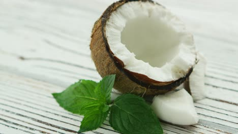 Halves-of-fresh-coconut-with-mint-leaves