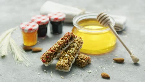 Cereal-bars-and-honey-in-arrangement