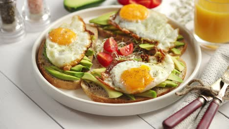 Delicious-healthy-breakfast-with-sliced-avocado-sandwiches-with-fried-egg