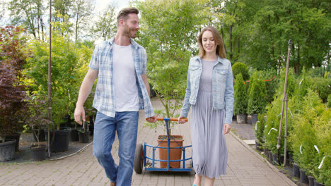 Happy-young-couple-in-plant-shop-just-bought-a-nice-potted-tree