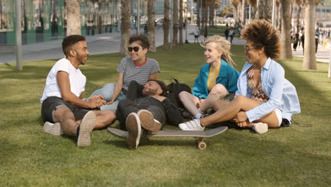 Laughing-diverse-friends-chilling-in-park