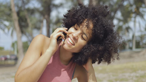 Charming-woman-speaking-on-phone-in-sunlight