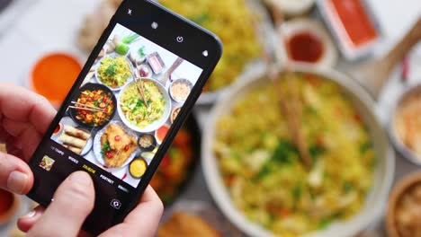 Woman-taking-a-photo-with-her-smartphone-Ready-for-social-media-Asian-food-concept