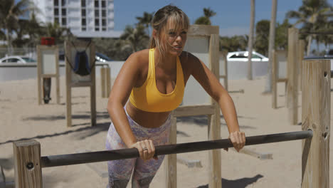 Serious-woman-working-out-on-shore