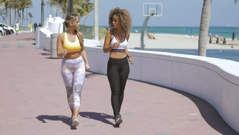 Sporty-women-running-together-on-shore