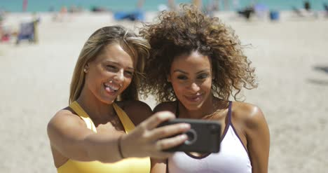 Sporty-women-taking-selfie-on-beach