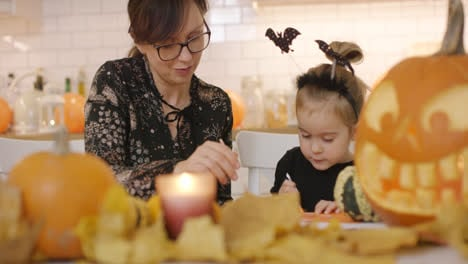 Woman-and-child-making-decorations