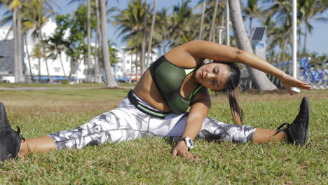 Woman-stretching-on-lawn