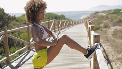 Sporty-girl-training-on-tropical-pier