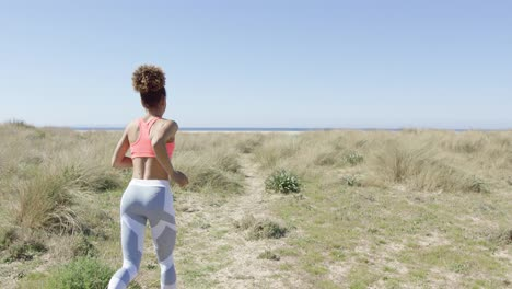Woman-jogging-on-the-beach
