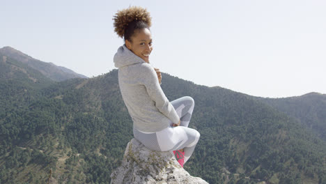 Sporty-woman-stretching-on-nature