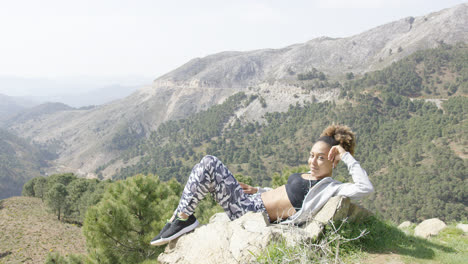 Relaxed-young-sportswoman-taking-rest