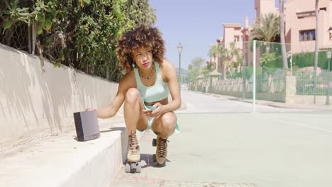 Woman-in-roller-skates-setting-on-music