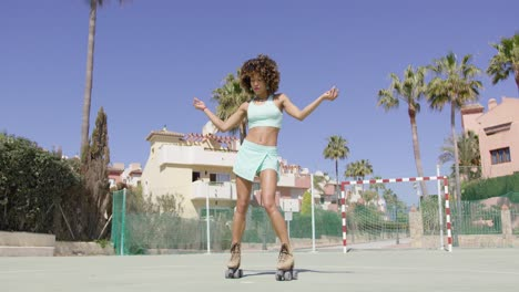 Young-pretty-woman-dancing-in-roller-skates