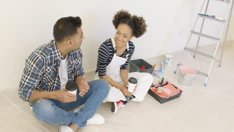 Young-couple-taking-a-break-from-redecorating