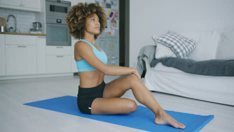 Woman-stretching-body-training-on-mat