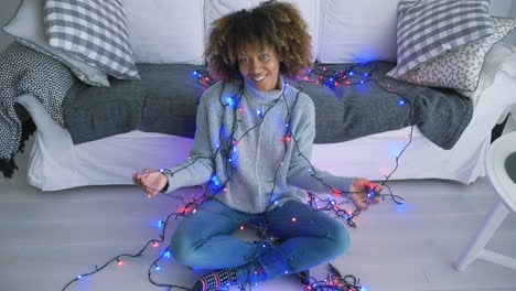 Woman-wrapped-in-blue-blinking-garland