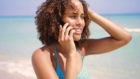 Laughing-woman-talking-phone-at-seaside