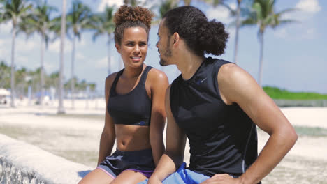 Athletic-couple-sitting-and-resting-after-sports