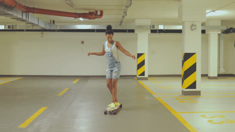 Girl-skateboarding-on-parking