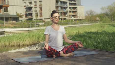 Young-woman-doing-yoga-near-home