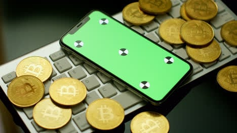 Phone-with-green-screen-and-bitcoins