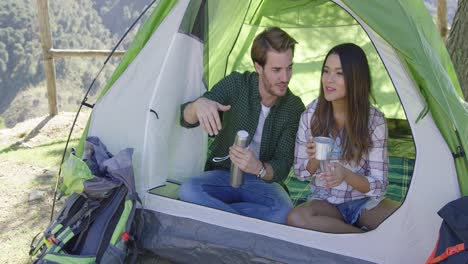 Happy-couple-having-rest-in-a-tent