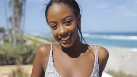 Smiling-woman-in-sportswear-on-beach