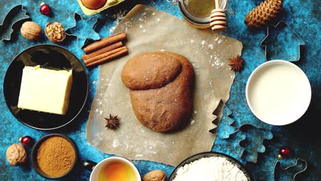 Gingerbread-dough-placed-among-various-ingredients--Christmas-baking-concept