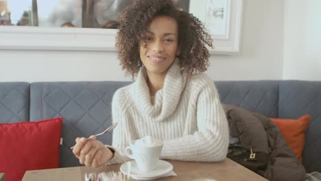 Portrait-of-beautiful-smiling-toothy-girl-having-a-relax-break-at-a-coffee-shop