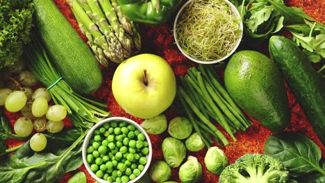 Fresh-green-vegetables-and-fruits-assortment-placed-on-a-rusty-metal