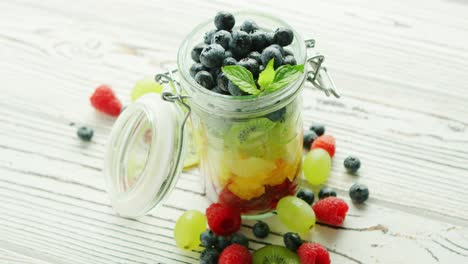 Jar-filled-with-colorful-fruit