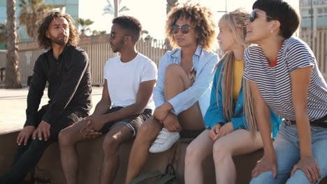 Content-young-friends-chilling-on-city-seafront