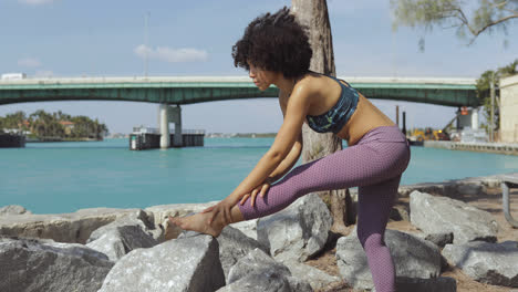 Black-girl-working-out-on-riverbank