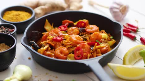 Falling-chive-on-Fresh-fried-noodles-with-vegetables-with-shrimps-served-in-black-iron-pan