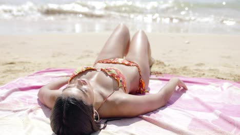 Beautiful-girl-sunbathing-on-beach