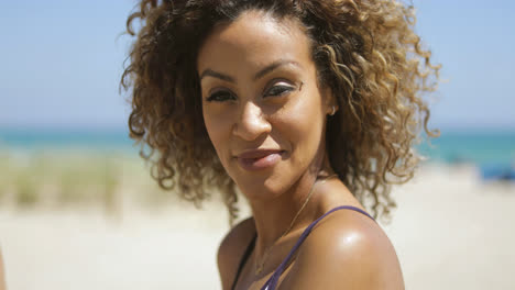 Pretty-curly-haired-woman-on-shore