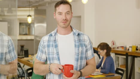 Man-with-coffee-in-office