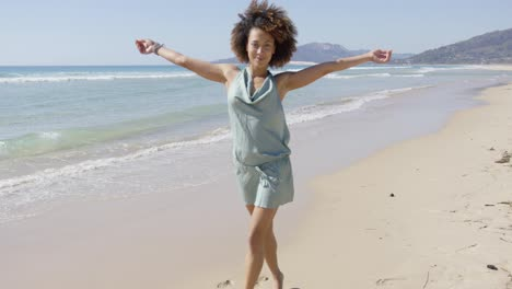 Female-wearing-summer-jumpsuit-posing-on-beach