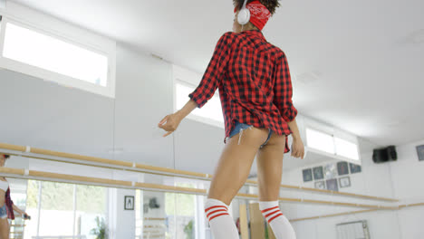 Low-angle-view-of-female-dance-student-in-shorts
