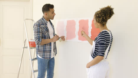 Young-couple-debating-a-new-paint-color