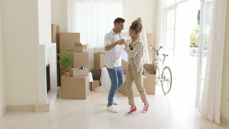 Happy-young-couple-celebrating-moving-home
