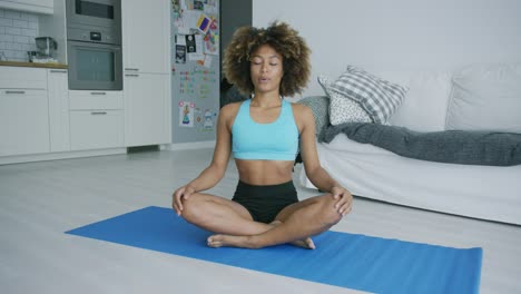 Content-woman-meditating-on-mat