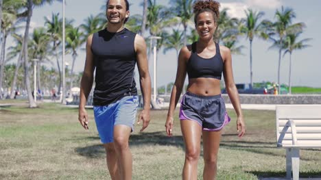 Smiling-couple-exercising-with-legs-up