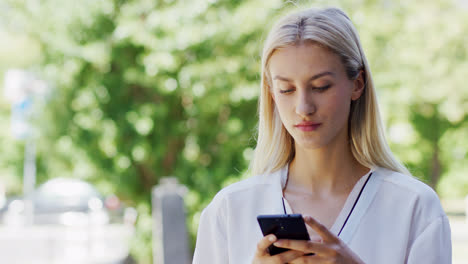 Young-lady-using-smartphone-on-street