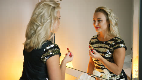 Pretty-woman-applying-evening-makeup